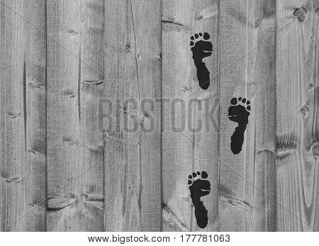 Human footprints on an old wooden board