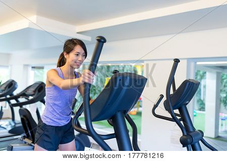 Woman training on Elliptical machine