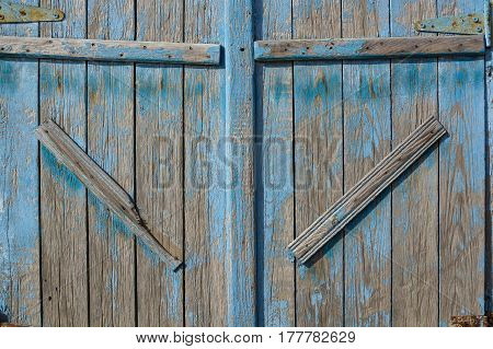 Closeup of large vintage barn door with obsolete blue paint