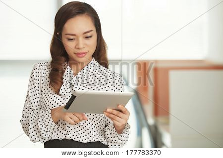 Female business executive reading something on tablet computer