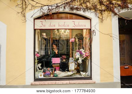 Burghausen,Germany-March 22,2017: Store window displaying vintage clothes for sale