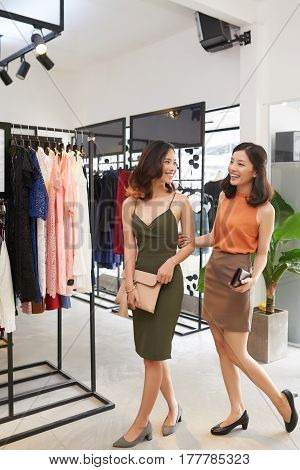 Young Asian women shopping for clothes in boutique