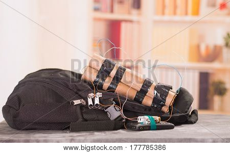 Close up shot of improvised explosive device bomb on a black backpack