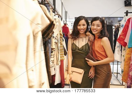 Portrait of Vietnamese smiling female friends in clothing store