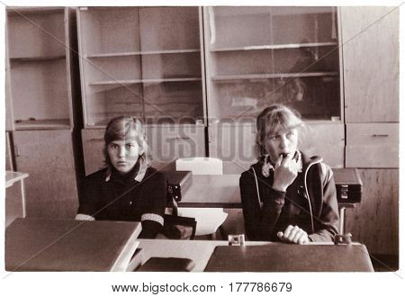 SENNO BELARUS - CIRCA 1985: Two schoolgirls-tenth graders in classroom on break (vintage photo 1985) Senno Belarus