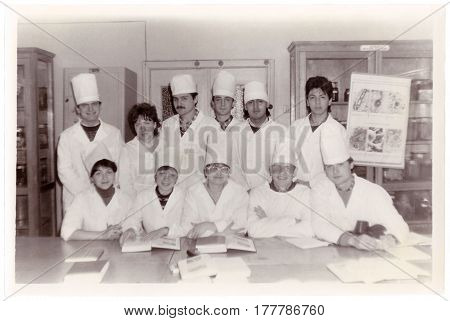 VITEBSK BELARUS - CIRCA 1987: Students of Vitebsk of Order of Friendship of Peoples Medical Institute at Department of Histology (group vintage black and white photo 1987) Belarus