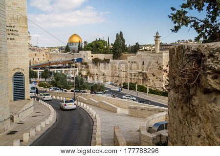 JERUSALEM, ISRAEL - DECEMBER 8: The Western Wall, the Dome of the Rock and the Mughrabi Gate on the Temple Mount, view from the wall in the Old City of Jerusalem, Israel on December 8, 2016