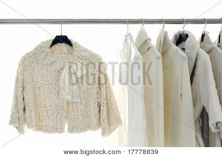 Clothing hanger with white jacket