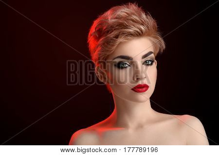 Black and red. Gorgeous young blonde woman with smoky eyes makeup and red lipstick posing on black background copyspace beauty grace elegance perfection sensuality sexy hot cosmetics concept