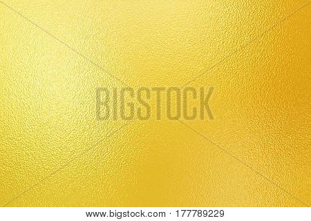 Shining gold foil. Yellow metallik texture background. Metallized paper