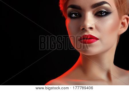 Lady look. Horizontal close up of a stunning young beautiful woman wearing red lipstick and dark smoky eyes makeup copyspace visage cosmetics beauty skincare perfection unblemished concept