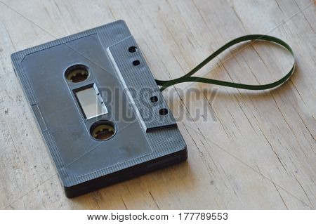 magnetic tape out from cassette on wooden board