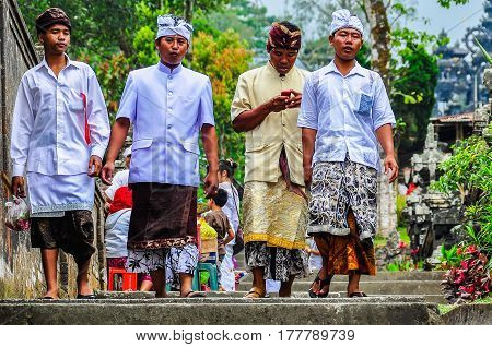 PURA BESAKIH, INDONESIA - SEPTEMBER 30, 2012: Local people in Pura Besakih Temple in Bali Island Indonesia