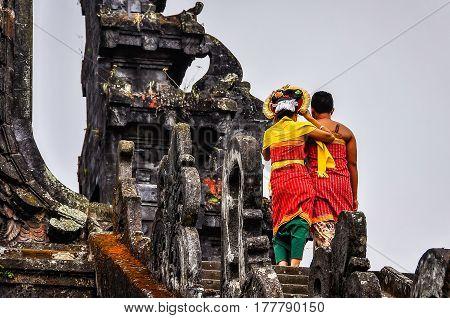 PURA BESAKIH, INDONESIA - SEPTEMBER 30, 2012: Local couple in Pura Besakih Temple in Bali Island Indonesia