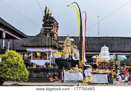PURA BESAKIH, INDONESIA - SEPTEMBER 30, 2012: Traditional ritual in Pura Besakih Temple in Bali Island Indonesia