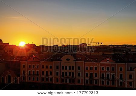 The sun rises above the spring city at dawn