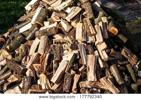 Cut Logs Fire Wood. Pile Of Chopped Fire Wood Prepared For Winter Ready For Burning.
