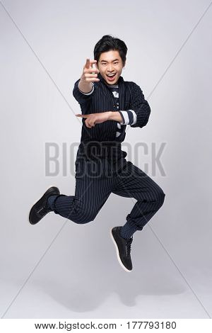 Active young handsome asian man. Cool fashion male model jumping