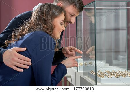 I see the one I want Shot of a young woman shopping jewelry with her loving boyfriend