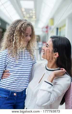 Happy mother and daughter enjoying in shopping mall