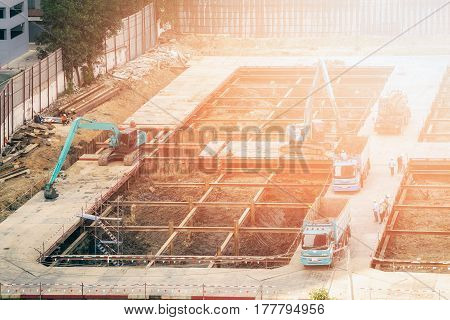 Construction engineer and foreman worker woking at construction site for new building construction project