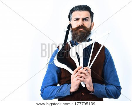 Bearded Man Holding Clothes Racks With Serious Face