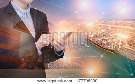Double exposure asian business woman use smart technology with container shipping boat at shipping yard.Photo concept for Global business shippingLogisticImport and Export industry.