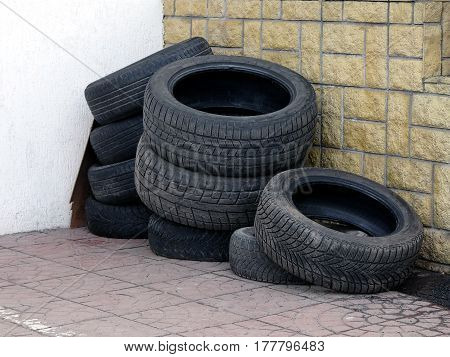 Used tires in the corner of the yard in the warehouse