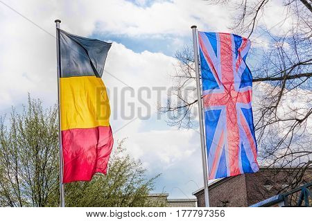 Country flags arranged against a blue sky.