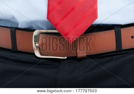 Close-up Of Man Belt And Red Tie