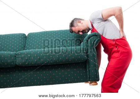 Mover Guy Lifting Up A Heavy Couch Having Back Pain