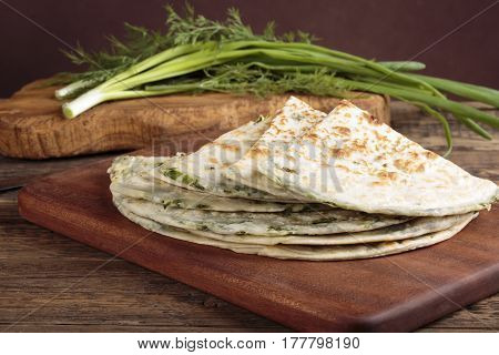 Scallion pancakes. Round unleavened flatbread minced green onions and dill.