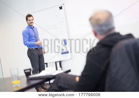 Job interview - businessman listen to candidate answers. Two men meeting in the office.