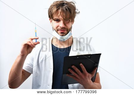 Bearded Caucasian Doctor Or Postgraduate Student With Clipboard And Syringe