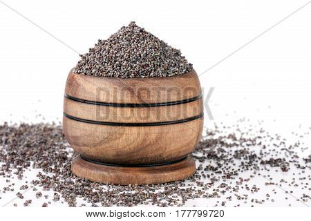 poppy seeds in a wooden spoon isolated on white background.