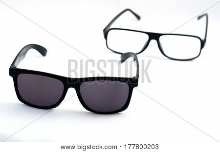 Two Pairs Of Glasses: Sunglasses And Corrective Eye Glasses