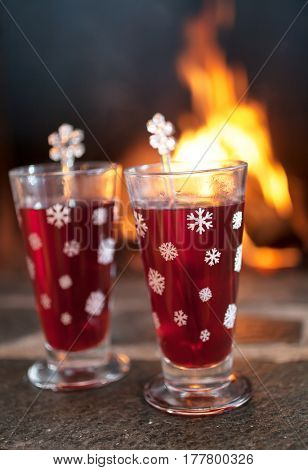 Mulled wine for two in front of fireplace