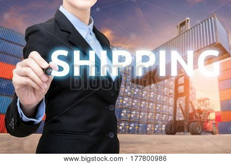 Smart Business woman is writing shipping word with cargo shipping containers in shipping yard.Photo concept for Global business shippingLogisticImport and Export industry.