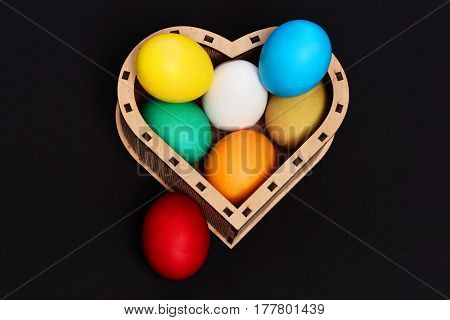 Easter Colorful Eggs In Wooden Heart Box Isolated On Black