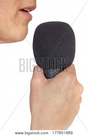 Side view of female mouth and microphone on white background