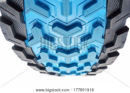 Bottom view of fromt part of colorful running shoe sole isolated on white