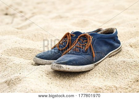 Simple Blue Men Shoes With Brown Laces On Sand On Beach