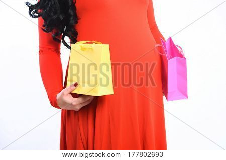 Female Hands Of Pregnant Woman Holding Package Or Bags