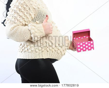 Female Hands Of Pregnant Woman Holding Present Or Gift