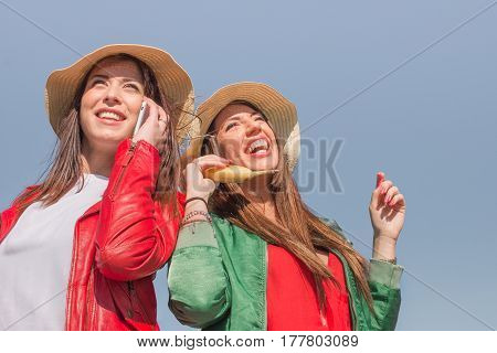 funny best friends. two girls having fun outdoors laughing and making jokes
