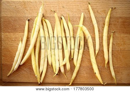 Yellow Beans (french Beans) On Rustic Wooden Table