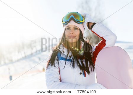 Beautiful woman in ski suit on snow resort
