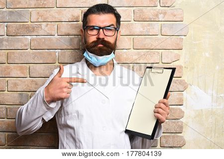 Bearded Brutal Caucasian Doctor Or Postgraduate Student With Clipboard