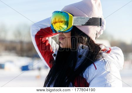 Portrait of sportswomen in sunglasses at winter mountains