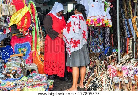Bali,Indonesia-May 28,2010:Market stall with colorful indigenous clothes & accessories at Tanah Lot Art Market Bali,Indonesia.Tanah Lot is one of the most popular places of interest in Bali,Indonesia.